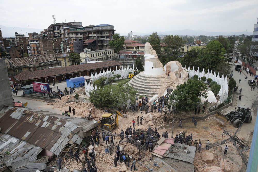 People inspect the damage of the collapsed landmark Dharahara, also called Bhimsen Tower, after an earthquake caused serious damage in Kathmandu, Nepal, 25 April 2015. At least around 600 people have been killed and hundreds of others injured in a 7.9-magnitude earthquake in Nepal, according to the country's Interior Ministry. People were being rescued from the rubble of collapsed buildings. Temples have crumbled all over the city, and houses and walls have collapsed. EPA/NARENDRA SHRESTHA
